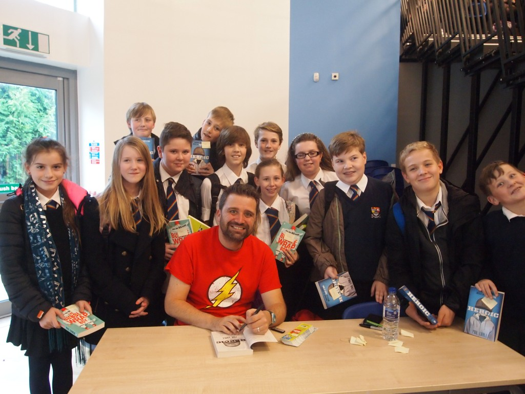 Phil with students after his Creative Writing Workshop
